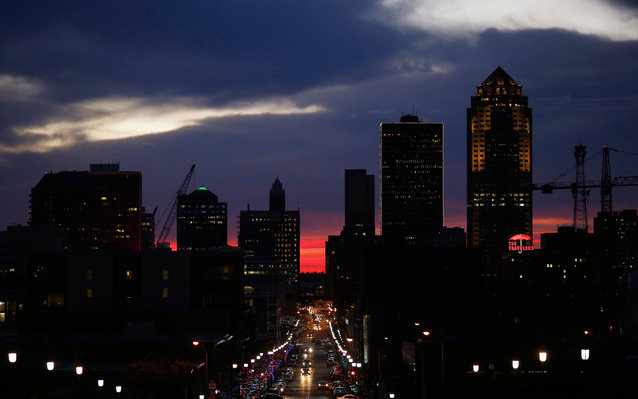 The silhouette of the downtown Des Moines skyline is seen as the sun sets in Des Moines, Iowa, U.S., on Friday, Jan. 29, 2016. As the first in the nation Iowa caucuses approaches, where registering your vote isn't as simple as casting a ballot, the state