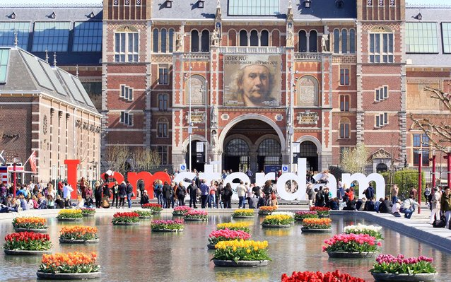 People enjoy in front of the Rijksmuseum in Amster