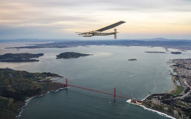 SAN FRANCISCO, CA - APRIL 23:  In this handout image supplied by Jean Revillard, Solar powered plane 'Solar Impulse 2', piloted by Swiss adventurer Bertrand Piccard, flys over the Golden Gate bridge in San Francisco, after a flight from Hawaii during its