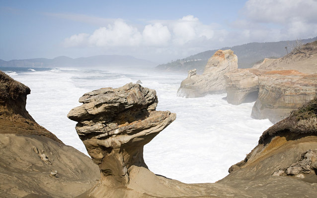 A group of people pushed down an iconic rock at Oregon's Cape Kiwanda.